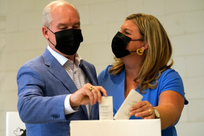 Conservative Leader Erin O'Toole and his wife Rebecca O'Toole cast their ballots for the Canadian general federal election in Bowmanville, Ontario.