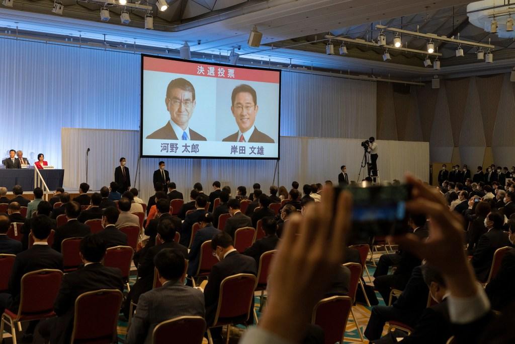 Liberal Democrat Party leadership candidates Taro Kono, left, and Fumio Kishida are seen, as Kishida won the governing party.