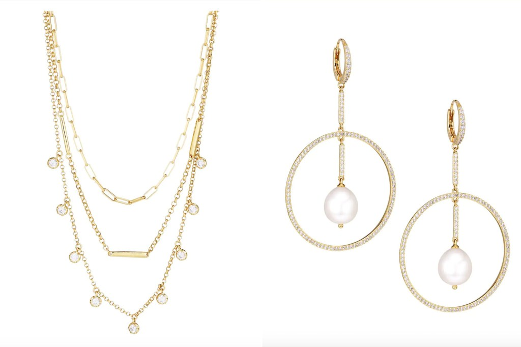 A gold necklace with three chains and a pair of circular gold and diamond hoop earrings