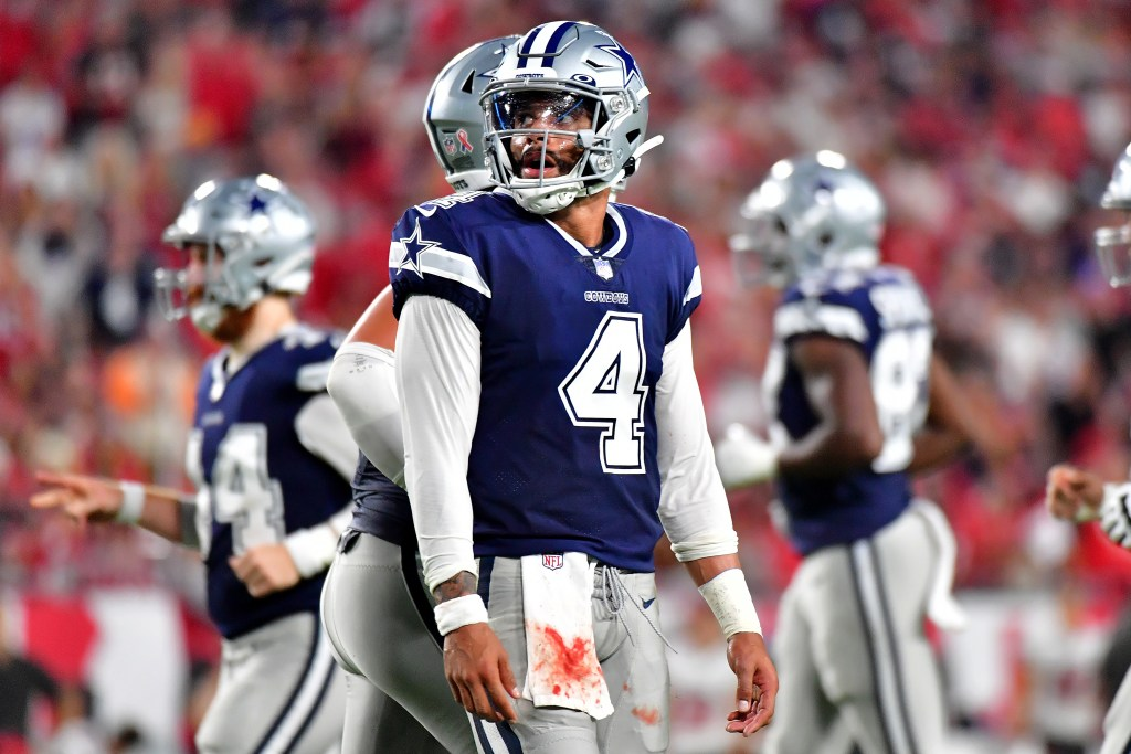 Dak Prescott threw for 403 yards and three touchdowns in Thursday's Opening Night loss to the Buccaneers.