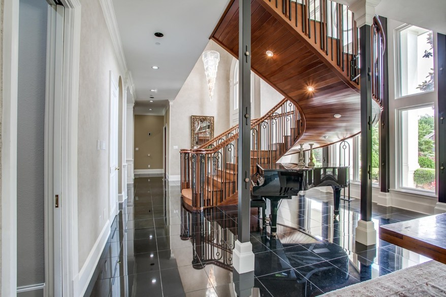 A staircase near the front door leads upstairs.