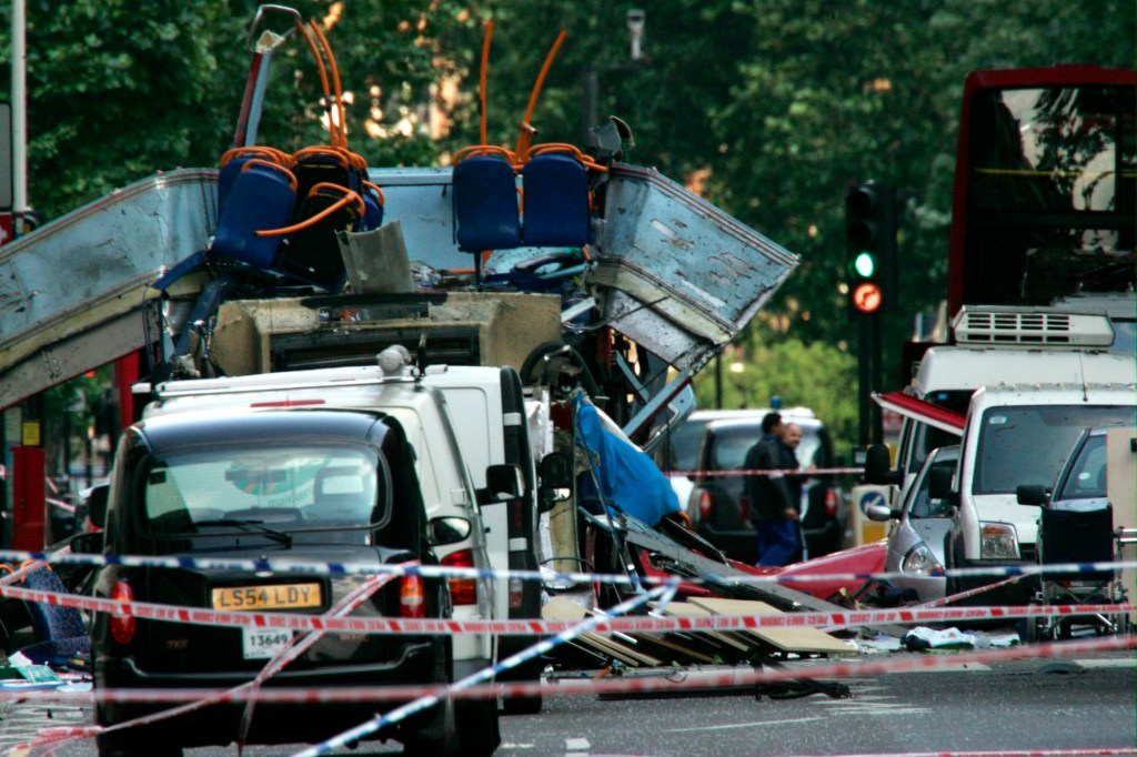 In this July 7, 2005 file photo file photo the wreckage of a double-decker bus with its top blown off by a bomb and damaged cars scattered on the road at Tavistock Square in central London. In the 20 years since the Sept. 11, 2001 terrorist attacks in the United States, a mixture of homegrown extremists, geography and weaknesses in counterterrorism strategies have combined to turn Europe into a prime target for jihadists bent on hurting the West.