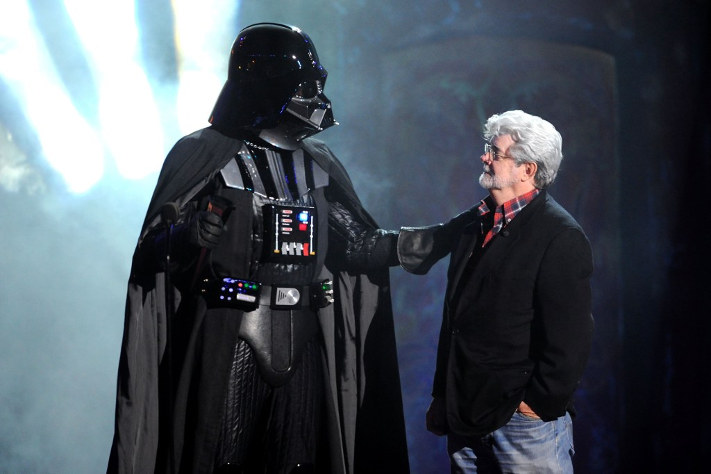 Director George Lucas and Darth Vader on stage