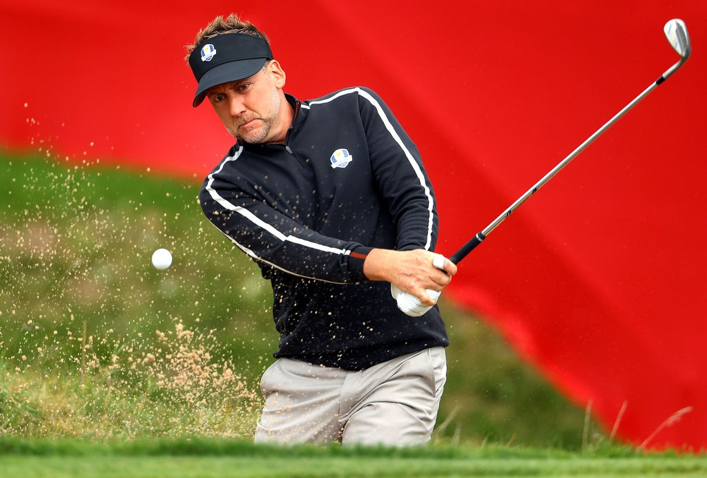 Ian Poulter of Team Europe hits a bunker shot during a Ryder Cup practice round.