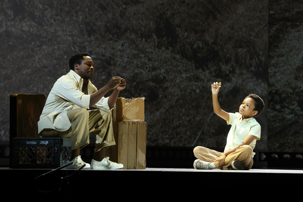 """Will Liverman, left, and Walter Russell III perform during a rehearsal of """"Fire Shut Up in My Bones"""" at the Metropolitan Opera, Friday, Sept. 24, 2021, in New York."""