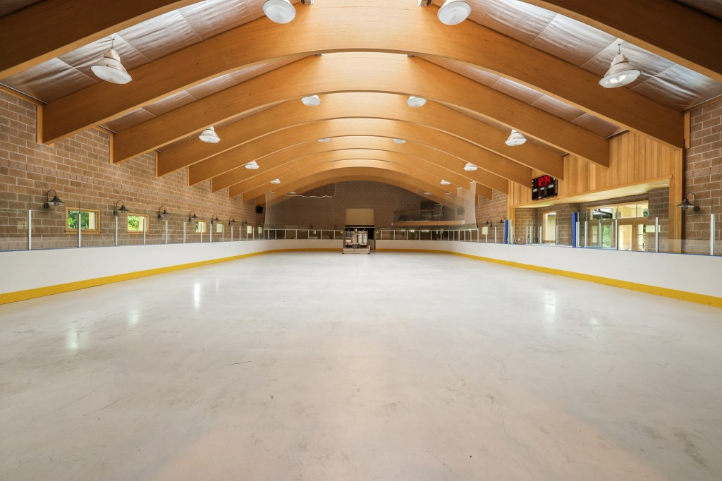The 5,300-square-foot ice hockey rink with a pitched roof cost  $420,000 at the time it was built, according to permit records.