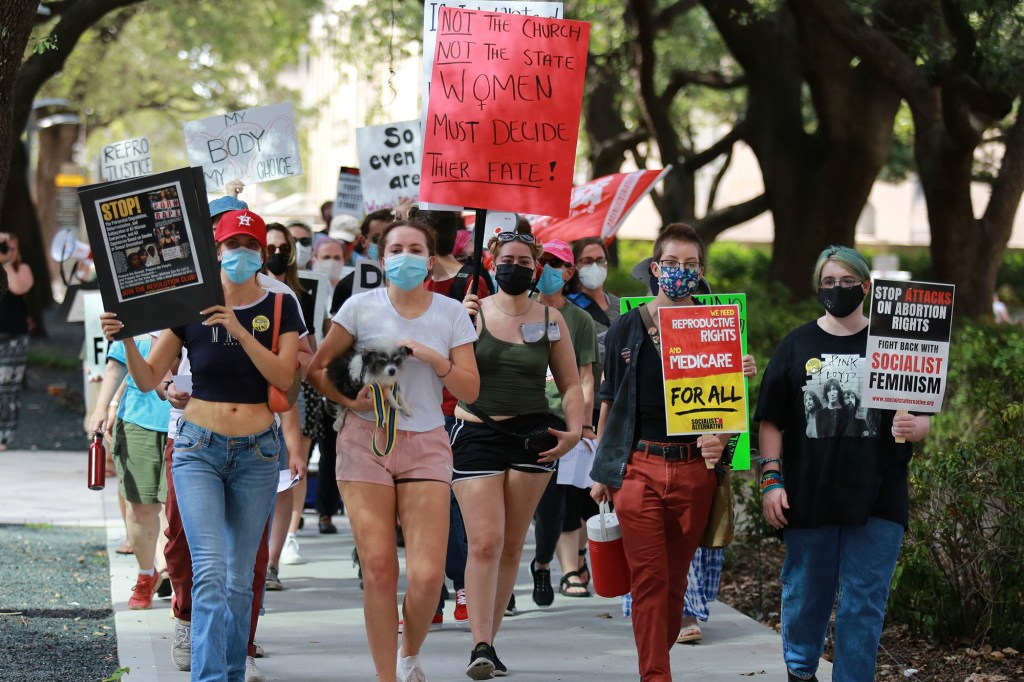 Demonstrators march from City Hall to the federal courthouse in Houston in protest of the Texas anti-abortion law on September 5, 2021.