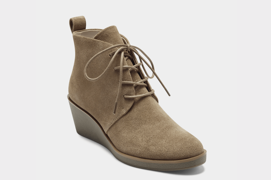 A tan colored bootie with laces