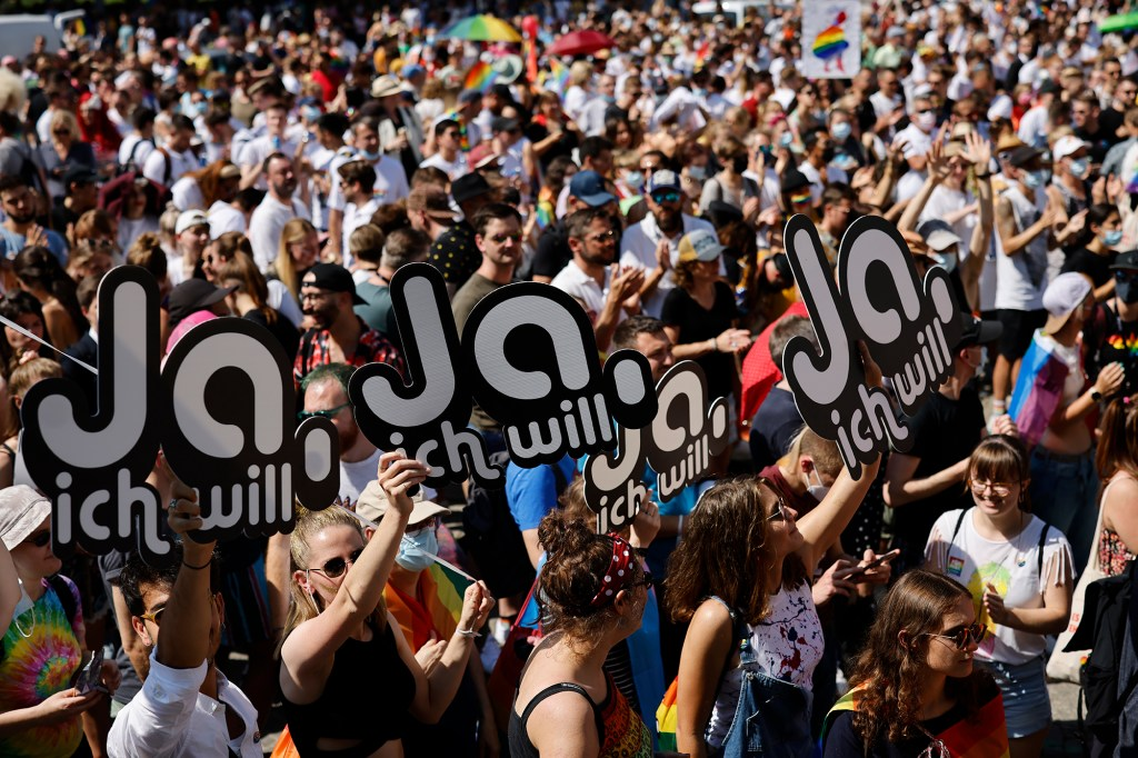 In this Saturday, Sept. 4, 2021 file photo, people gather for the Zurich Pride parade in Zurich, Switzerland. Swiss voters will wrap up a referendum on Sunday Sept. 26, 2021, to decide whether to allow same-sex marriage in the rich Alpine country, with supporters hoping for a big step toward ending discrimination against gays and lesbians while opponents fear what they consider an erosion of traditional family values.