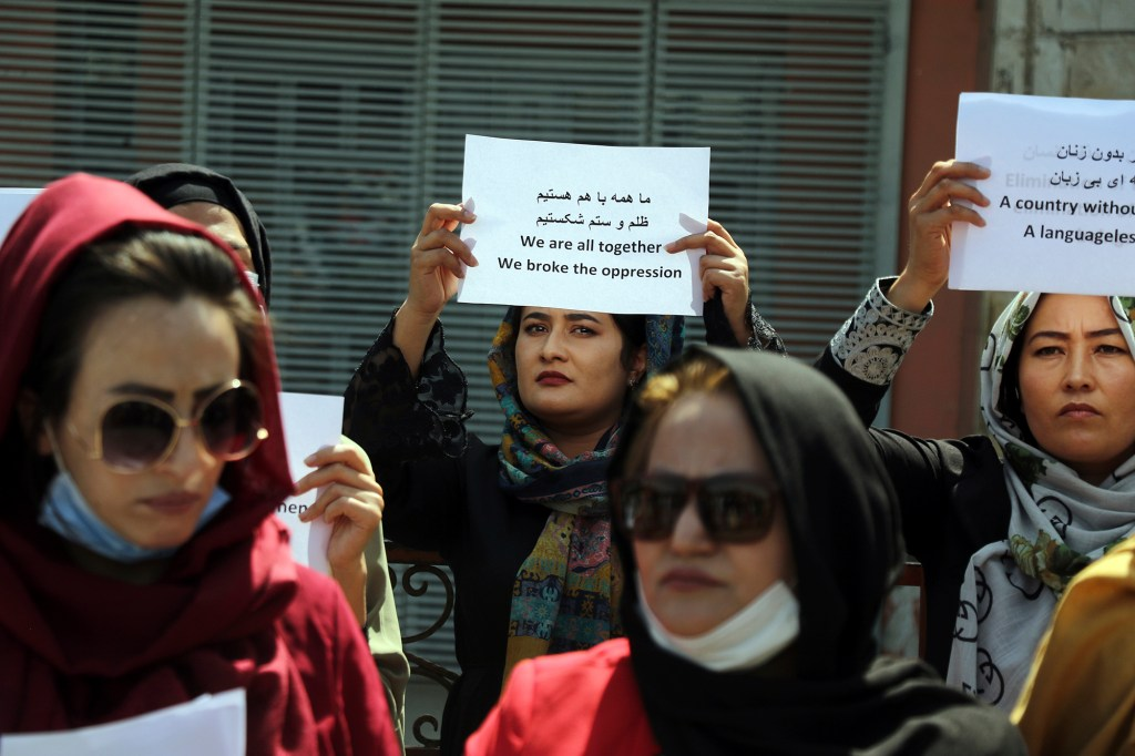 Women gather to demand their rights under the Taliban rule during a protest in Kabul, Afghanistan,