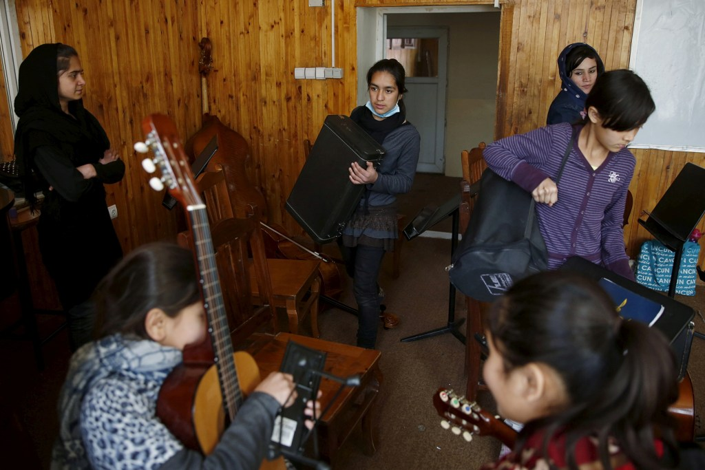 Members of the Zohra orchestra, an ensemble of 35 women, practices during a session, at Afghanistan's National Institute of Music, in Kabul, Afghanistan April 4, 2016.