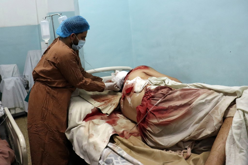 A victim of the airport bombing in the hospital receiving medical care.