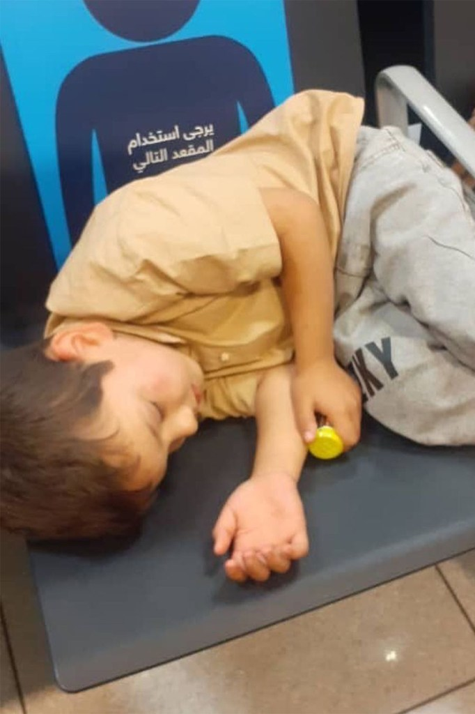 A child sleeping at an airport in the United Arab Emirates.