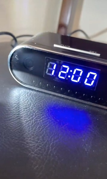 An alarm clock with a secret camera could be pointed at the bed.
