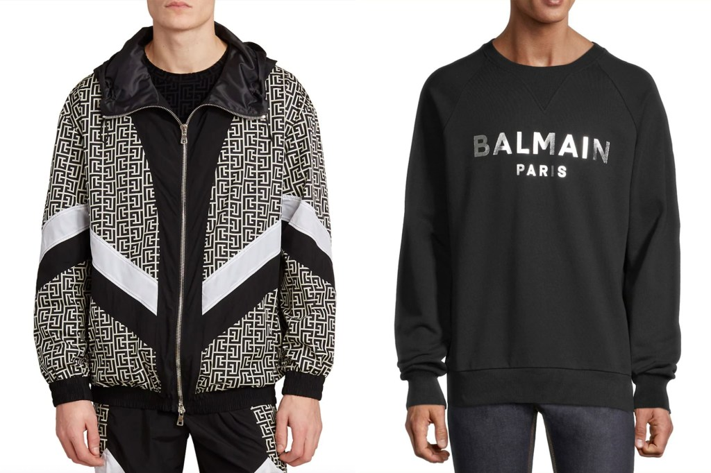 Two men side by side, one in a black and white windbreaker and one in a Balmain branded black crewneck