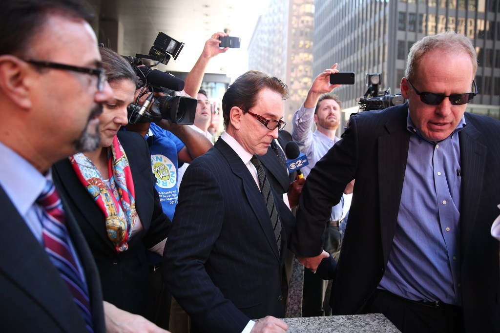 Warner is pictured leaving the Dirksen U.S. Courthouse in Chicago, Illinois in 2013 after entering a guilty plea for tax evasion.