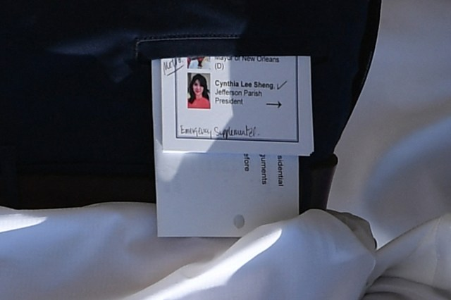 A note card is seen in the back pocket of US President Joe Biden after he arrived at Louis Armstrong New Orleans International Airport.