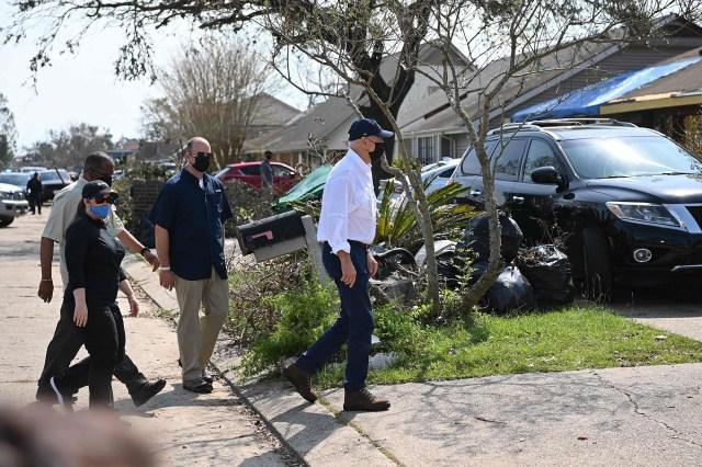 President Joe Biden walks to a home wrecked by Hurricane Ida in LaPlace, Louisiana.