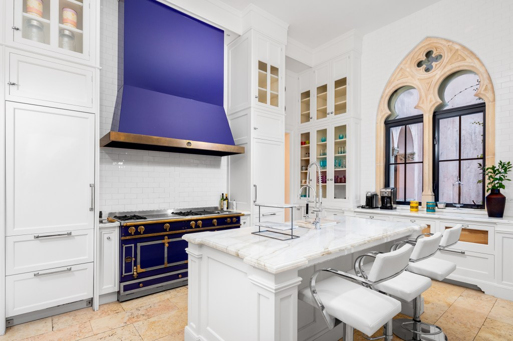 The chef's kitchen has purple finishes, matching the purple roof in the great hall.
