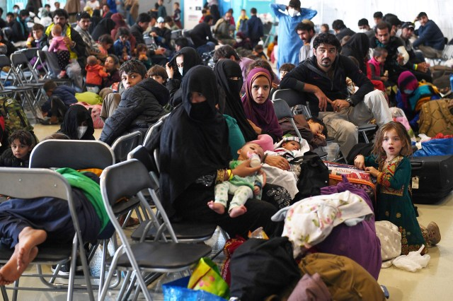 Afghan refugees are processed inside Hangar 5 at Ramstein Air Base in Germany, on September 8, 2021.