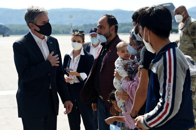 U.S Secretary of State Antony Blinken meets with a family of Afghan refugees at Ramstein Air Base in Germany, September 8, 2021.