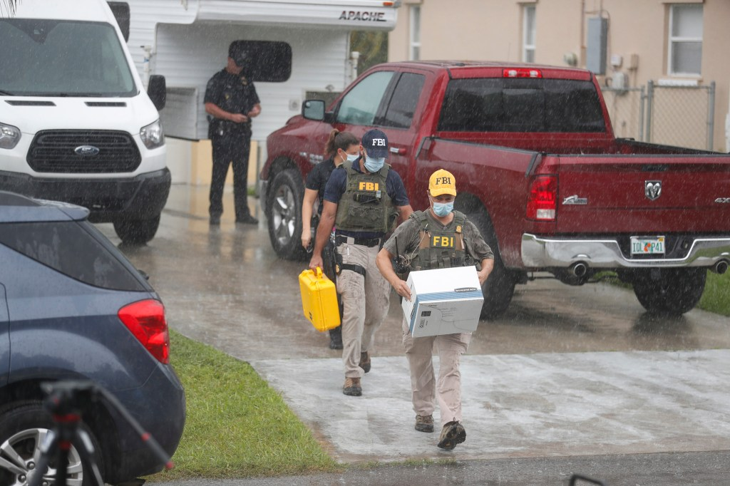 FBI agents take away evidence from the family home of Brian Laundrie.