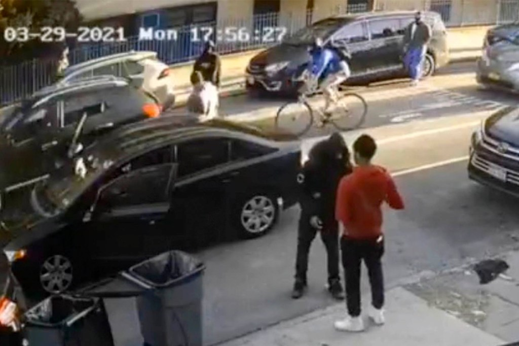 A broad daylight carjacking was caught on camera on a busy Brooklyn street.