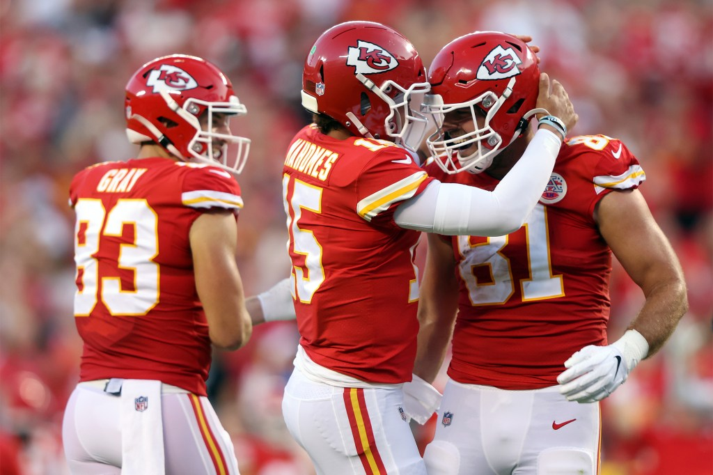 Quarterback Patrick Mahomes #15 of the Kansas City Chiefs congratulates tight end Blake Bell #81 after Bell caught a pass for a touchdown during the 1st quarter of the preseason game against the Minnesota Vikings