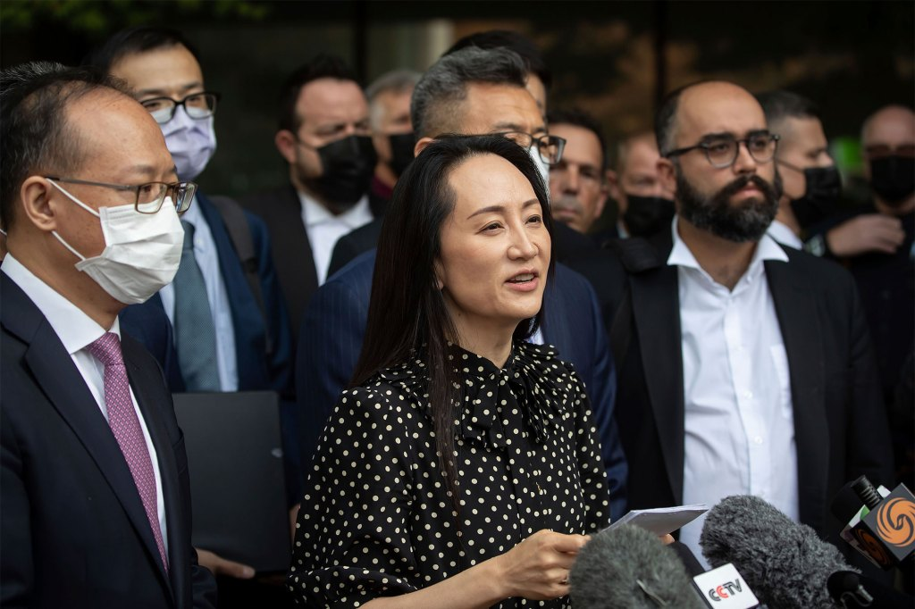 Meng Wanzhou, chief financial officer of Huawei, reads a statement outside B.C. Supreme Court in Vancouver, British Columbia on Sept. 24, 2021.