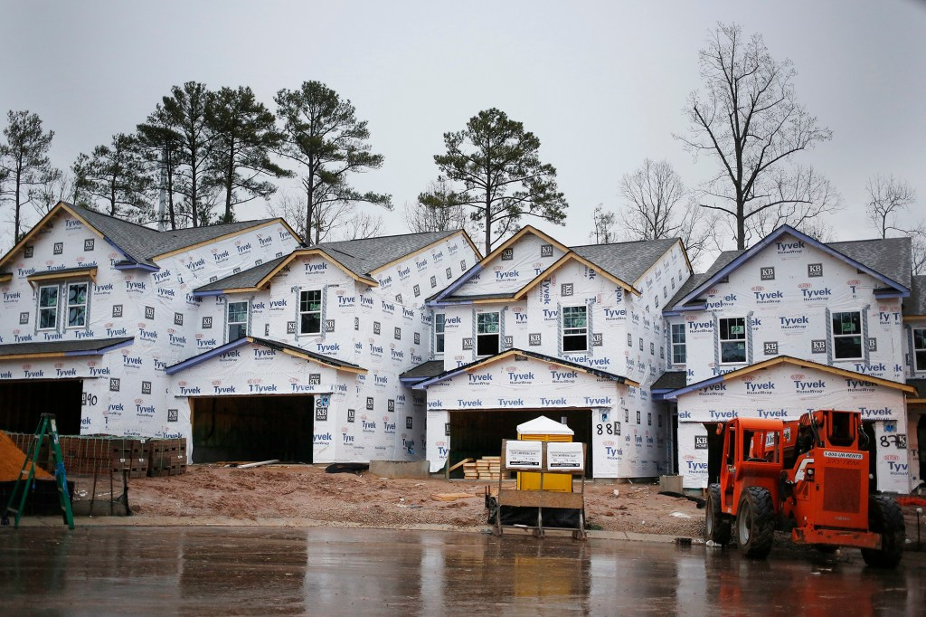 Houses in progress covered with Tyvek