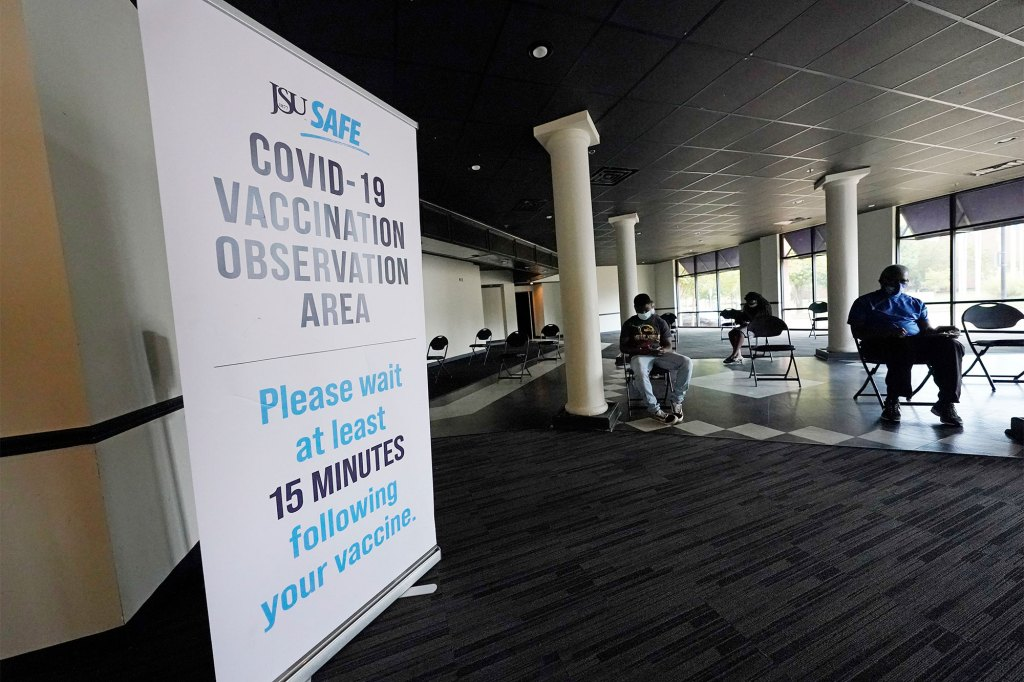 COVID-19 vaccine recipients sit for 15 minutes at a Jackson State University facility in Jackson, Mississippi on September 21, 2021.