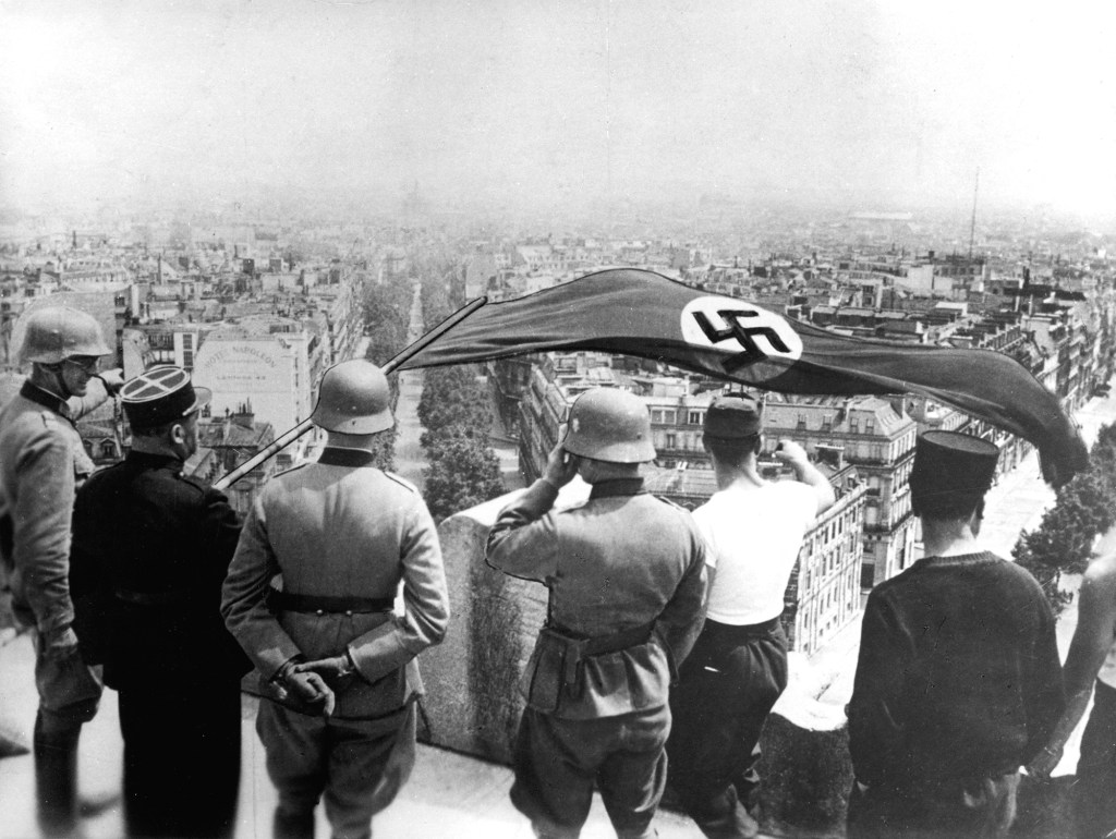 German occupation of Paris, World War II, June 1940. The Nazi flag flying from the Arc de Triomphe.
