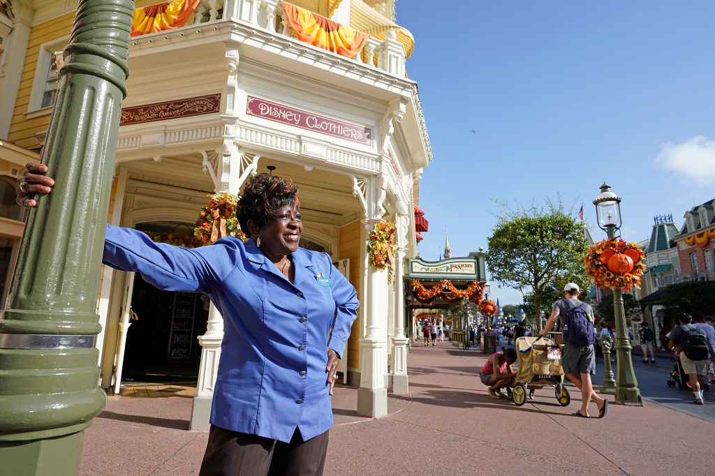 """Fifty-year employee Earliene Anderson stands on Main Street at the Magic Kingdom theme park at Walt Disney World Monday, Aug. 30, 2021, in Lake Buena Vista, Fla. """"Disney has been my love, and it still is,"""" Anderson said recently before starting her shift in merchandising."""