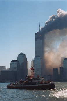 A fire department vessel loaded with evacuees departs N.Y. Harbor during the September 11 terrorist attacks.