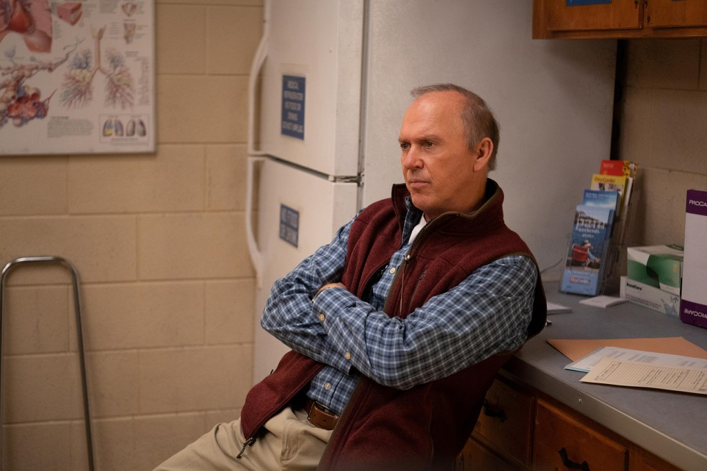 """Photo showing Michael Keaton, with his arms crossed, in a scene from """"Dopesick."""""""