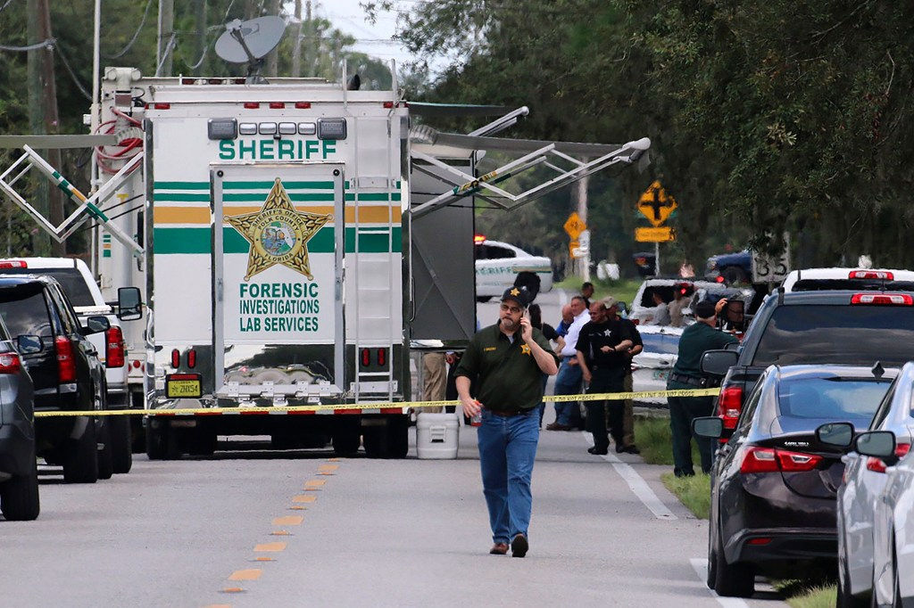 Polk County, Fla., Sheriff's officials work the scene of a multiple fatality shooting.