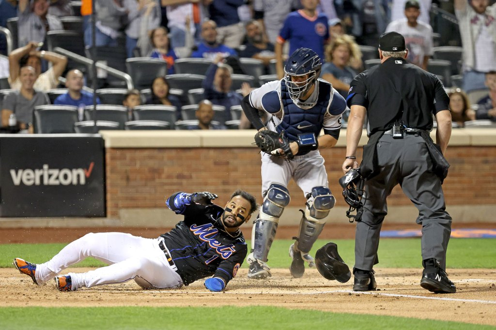 Jonathan Villar #1 of the New York Mets slides under Gary Sanchez #24 of the New York Yankees