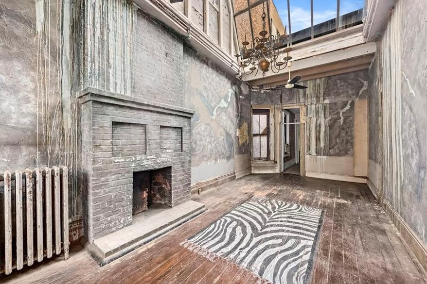 A zebra-print rug painted on the floor by past residents.