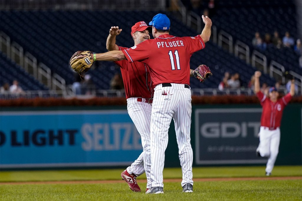 Rep. Greg Steube, R-Fla., left, celebrates with Rep. August Pfluger, R-Texas, after the Congressional baseball game.