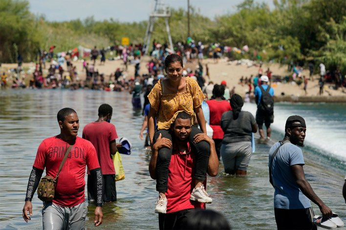 Haitian immigrants crossing into the United States from Mexico near Del Rio, Texas on September 18, 2021.