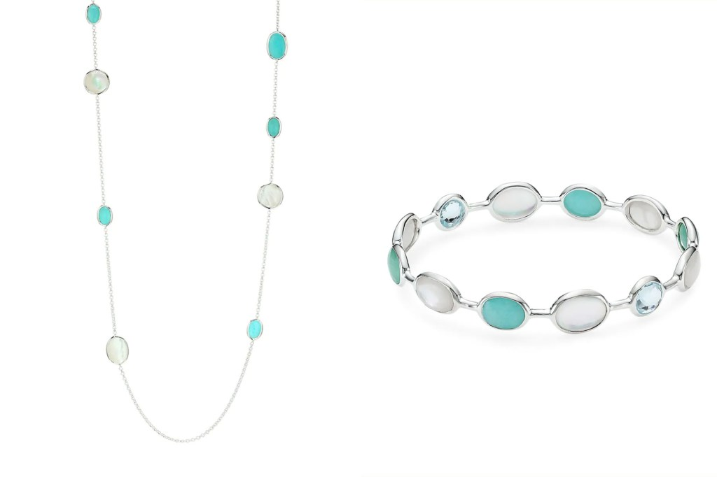 A silver and green necklace and a matching bracelet on a silver chain and band