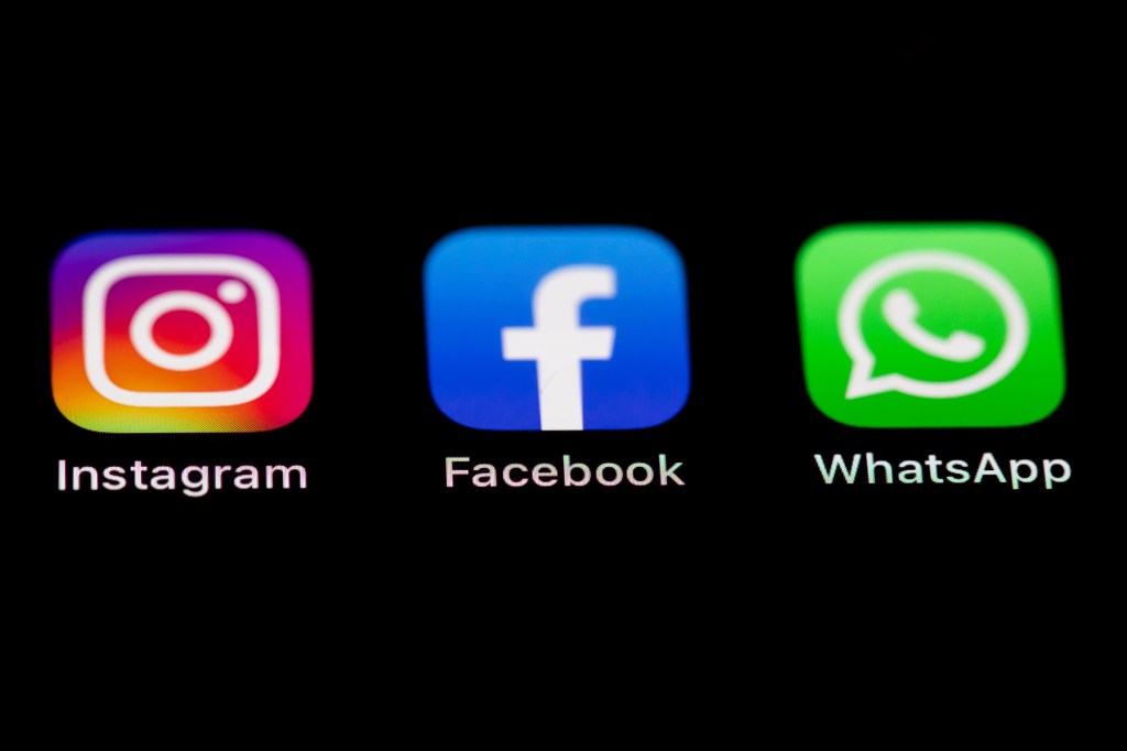 Logos of Instagram, Facebook and WhatsApp seen on a smartphone screen