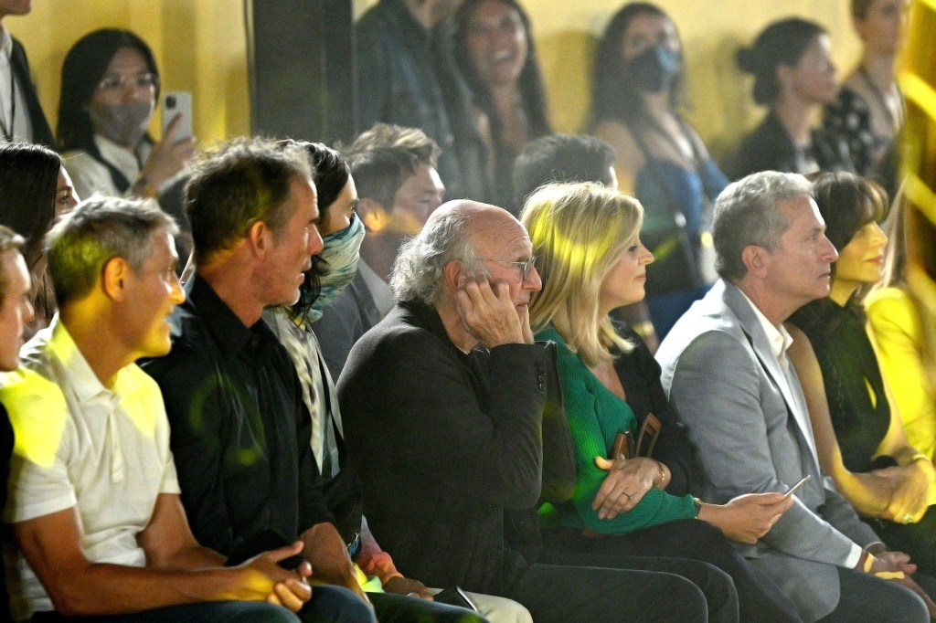 It didn't seem like Larry David was having a good time at Fashion Week.