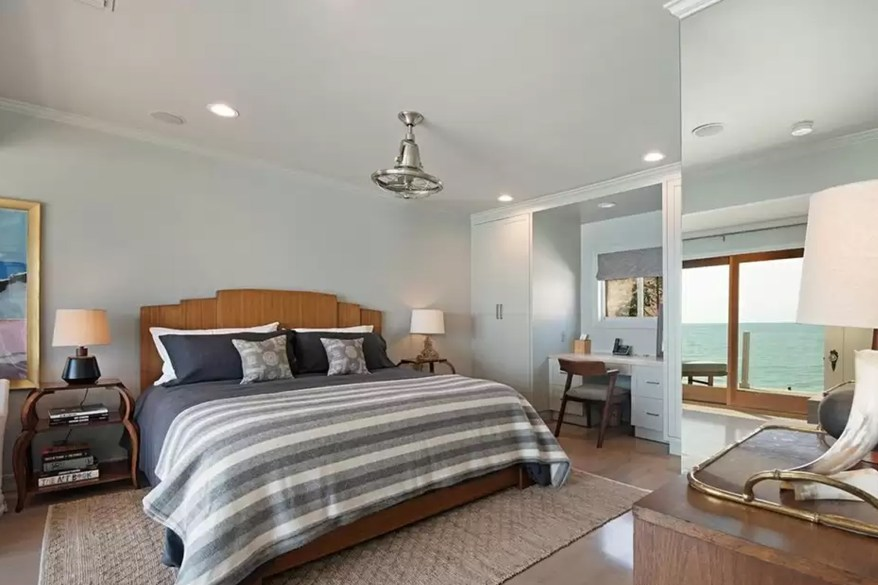 Pictured is one of the three bedrooms in DiCaprio's longtime Malibu homes.