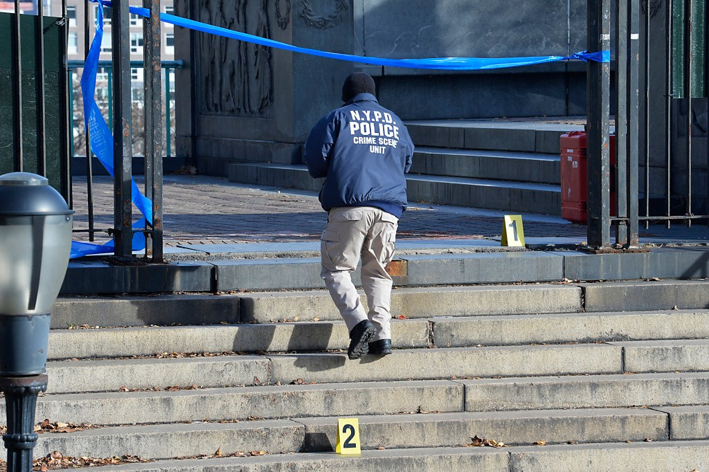 NYPD Detectives and members of the CSI Unit work the scene inside Morningside Park.