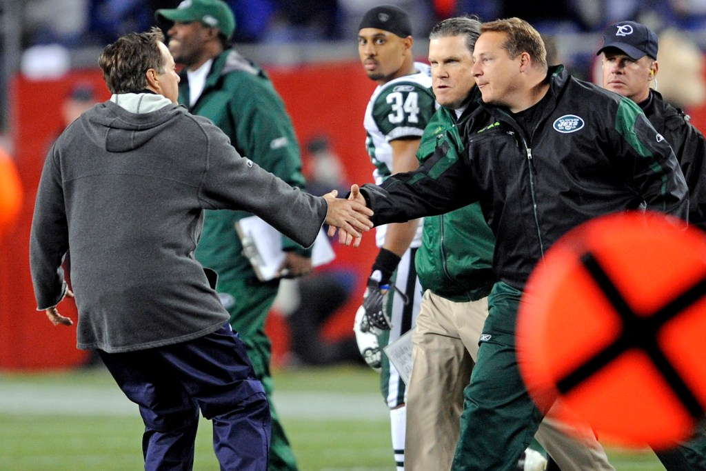 Eric Mangini (right) and Bill Belichick after a game on Nov. 13, 2008.