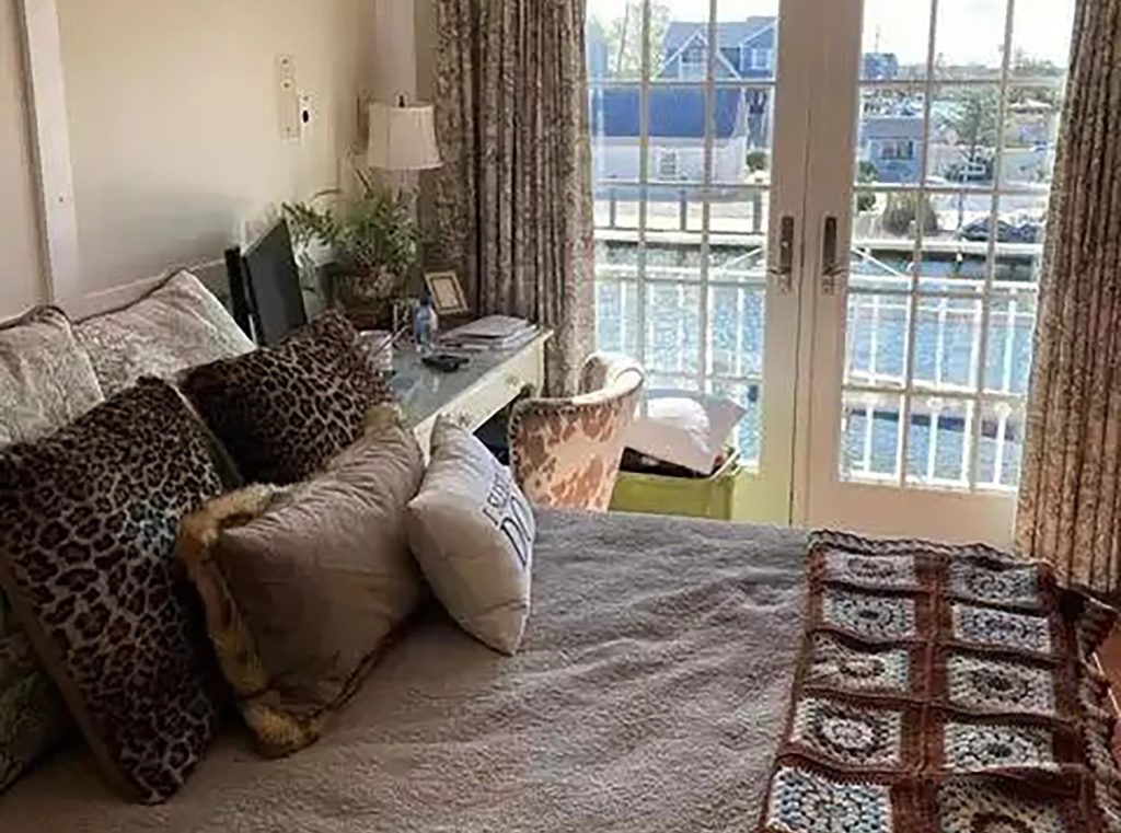 The master bedroom that leads to a terrace with waterfront views.