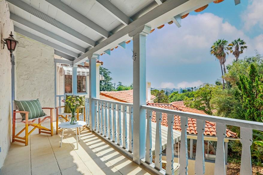 The balcony overlooks the pool.