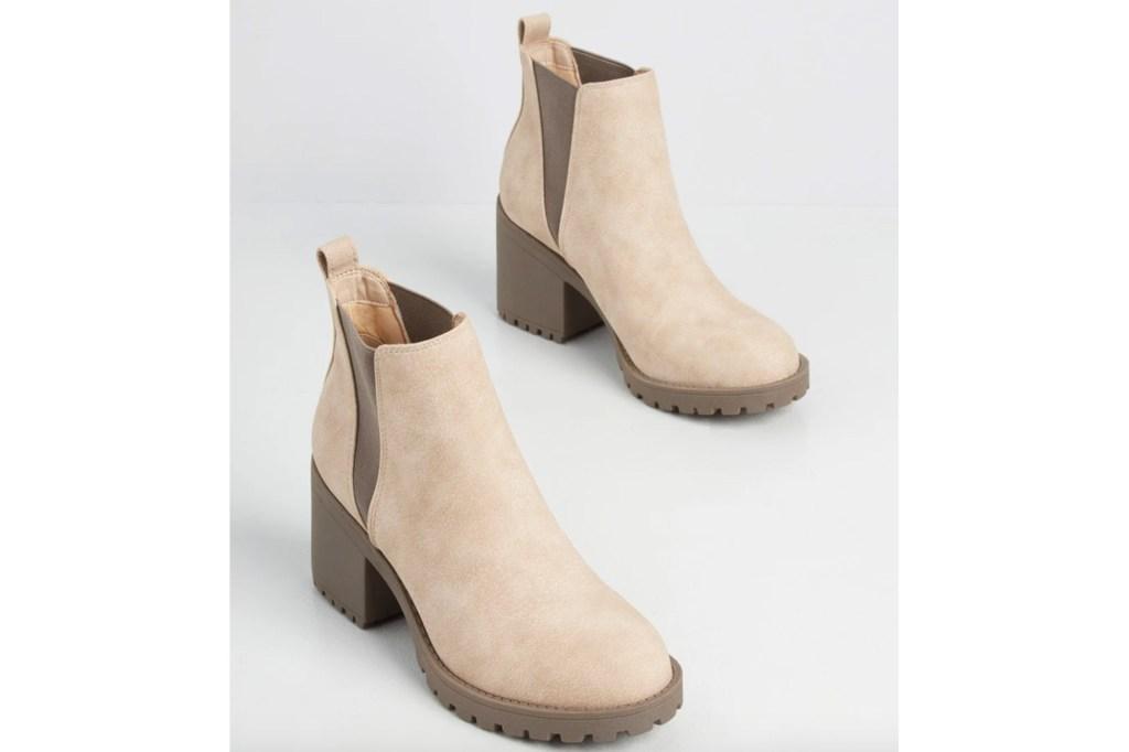 A pair of tan Chelsea booties