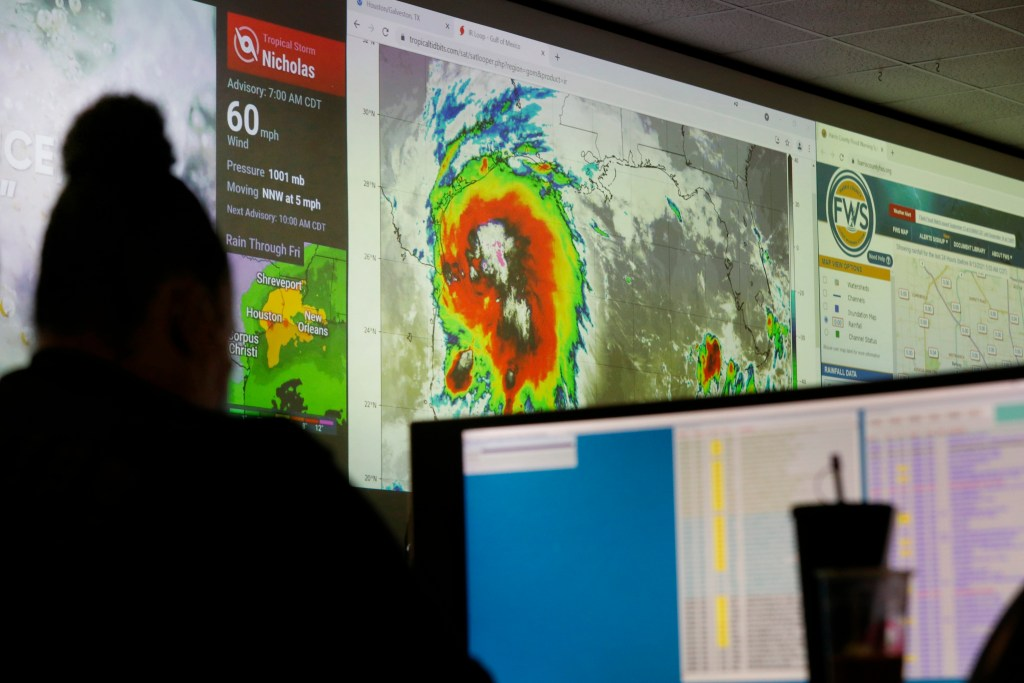 A Houston Police Department employee works at the city's emergency operations center as Tropical Storm Nicholas moves towards the Texas coast.